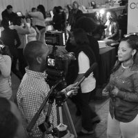 Host Ashley Simpson giving an interview